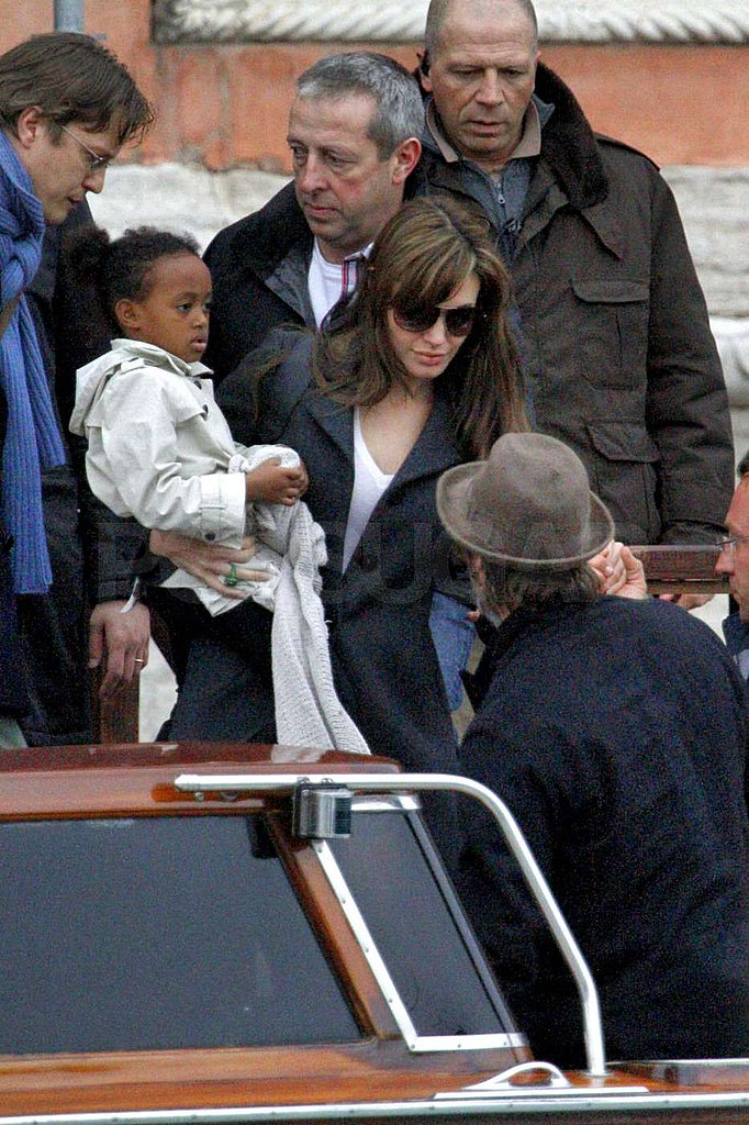 Photos of Brad and Angelina w/ kids