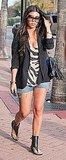 Kourtney Kardashian Walking in Miami in Black Blazer, Jean Cutoff Shorts, Zebra Tank