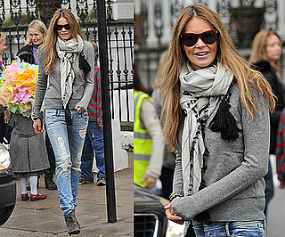 Elle Macpherson in London Wearing Ripped Jeans and Gray Boots
