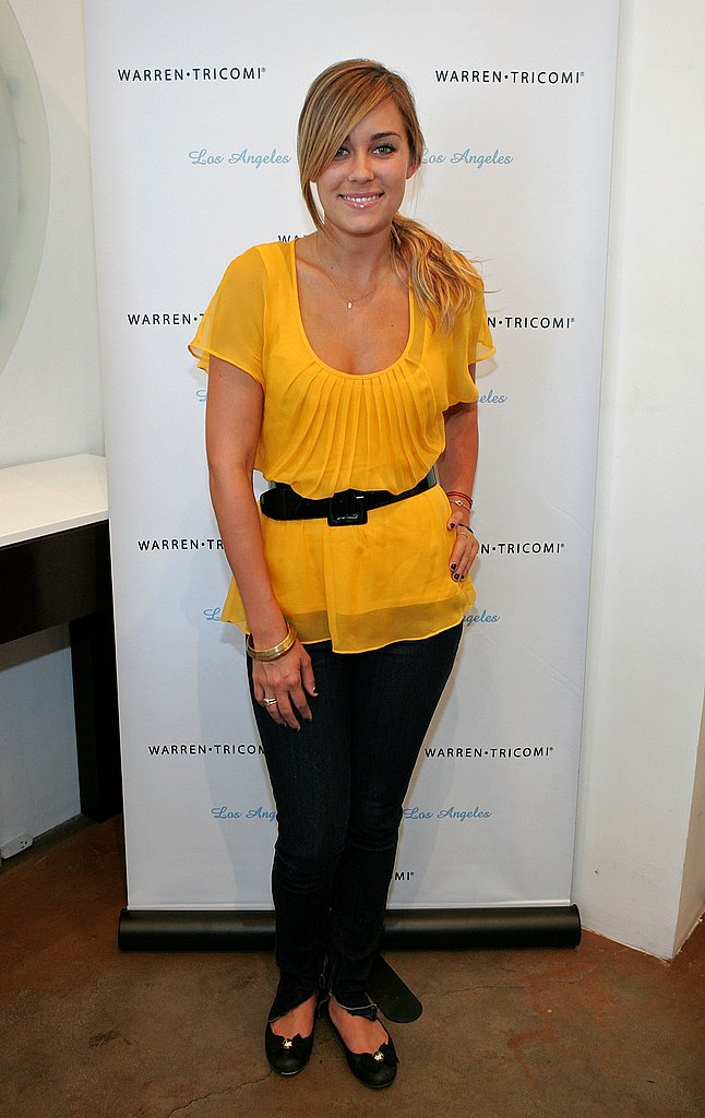 Preparing for the Season 3 premiere of The Hills at Warren-Tricomi Salon in a yellow top and jeans in August 2007.