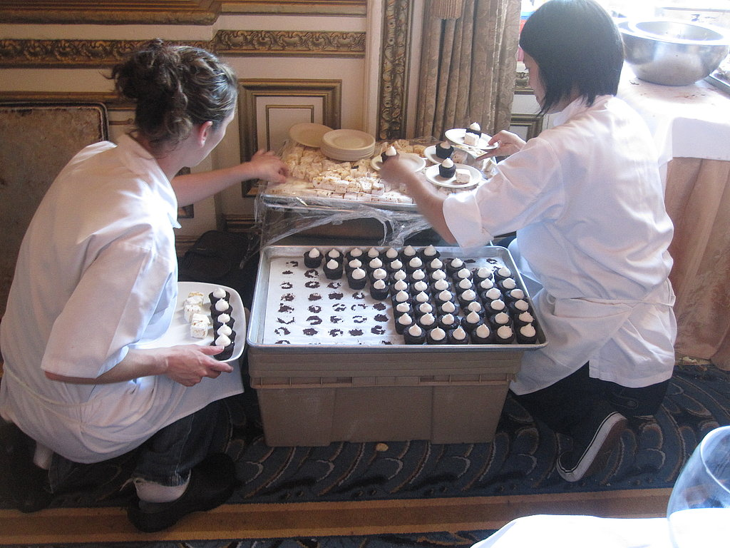 The pastry chefs work to plate the dessert.