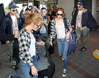 Pictures of Robert Pattinson and Kristen Stewart at LAX 2010-08-17 20:22:23