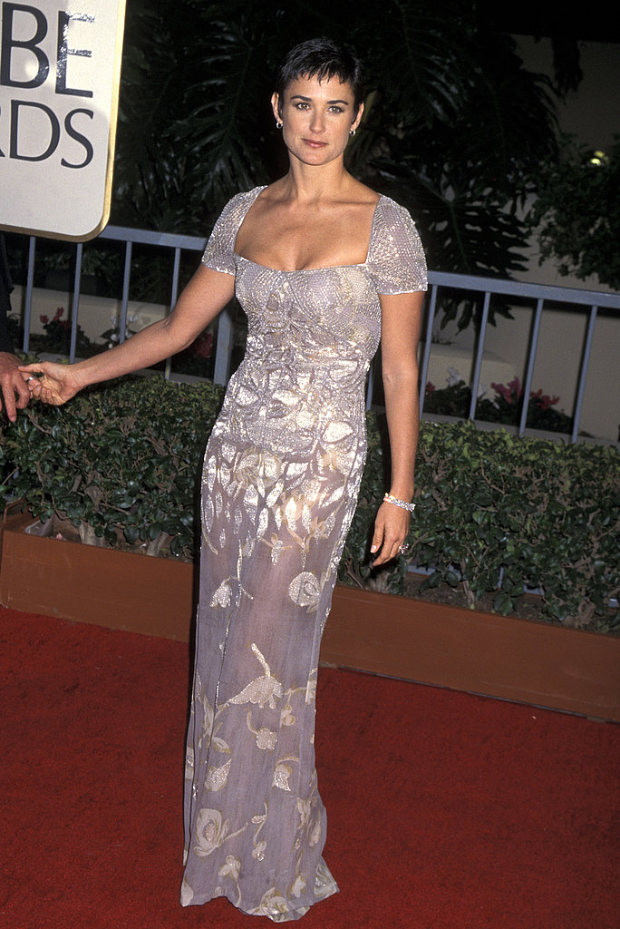 Walking the red carpet in iridescent florals at the Golden Globe Awards in '97.