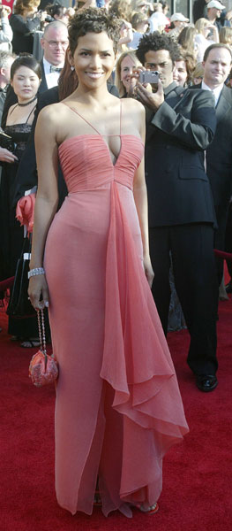 Halle went for a perky pink with a sexy neckline in 2003.