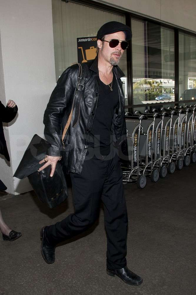 Brad Pitt Returns to LA With His Love Pendant on Display
