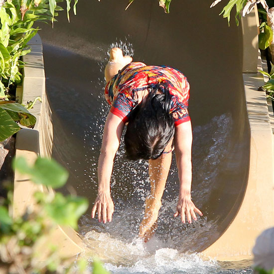Photo of Celebrity Going Down a Water Slide