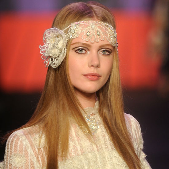 Are you all about shabby chic and vintage fabrics? Then skip the big tulle veil and don a simple band of fine lace. Wear a flower on the side like the look at Anna Sui, or just an unadorned band that you can make yourself.