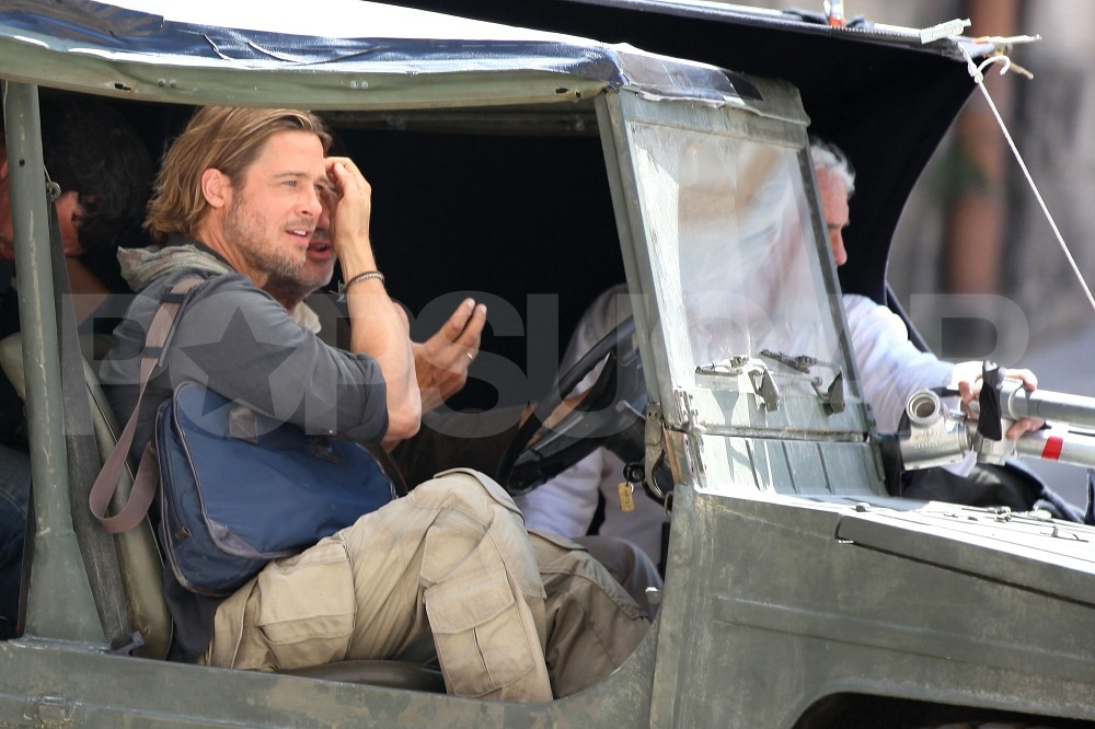 Brad Pitt Has a Smile and a Wave For His Sexy Working Saturday