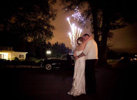 The happy couple stole a kiss during the fireworks at their Portland, OR, wedding.