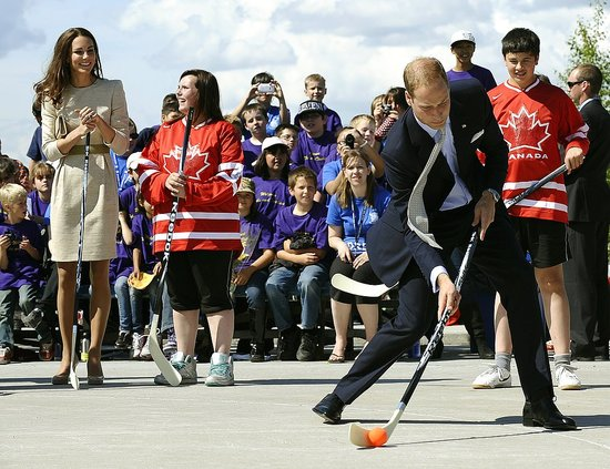 Prince William let loose as he swung a street-hockey stick.