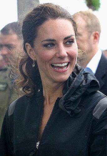Kate Middleton smiled through the rain drops.