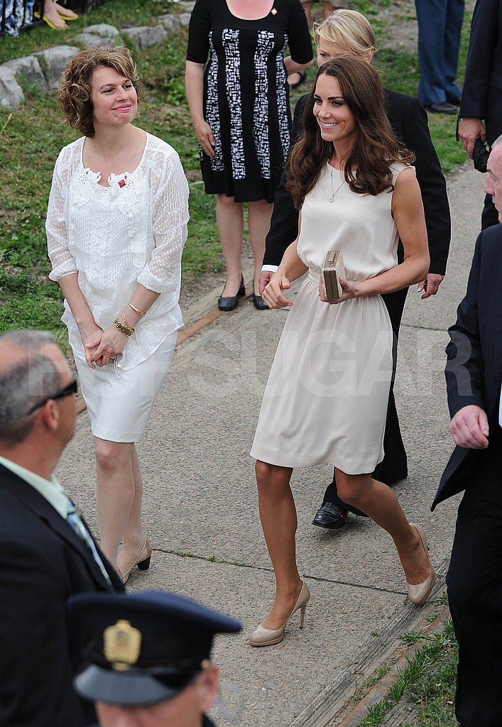 Kate Middleton paired nude pumps with a white dress.