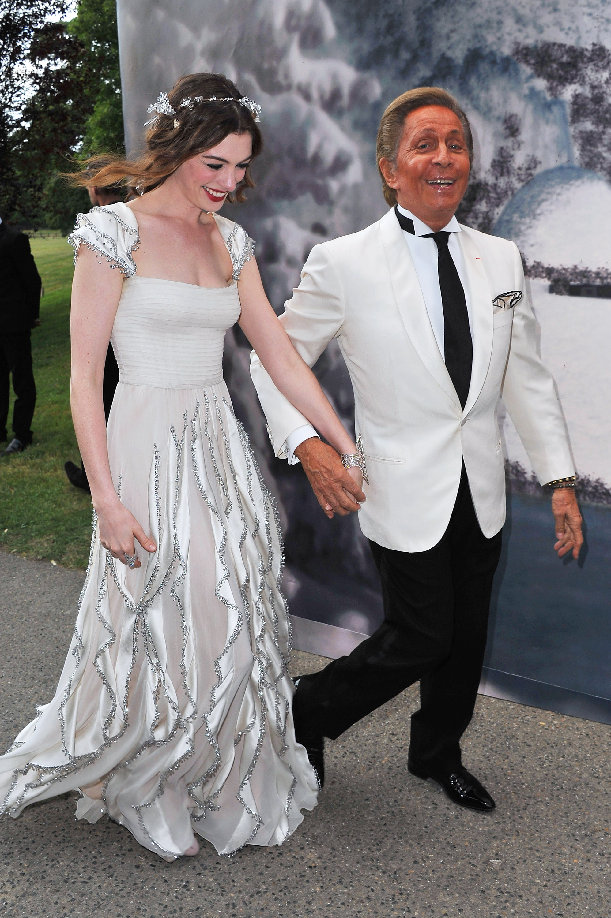 Anne and Valentino held hands.