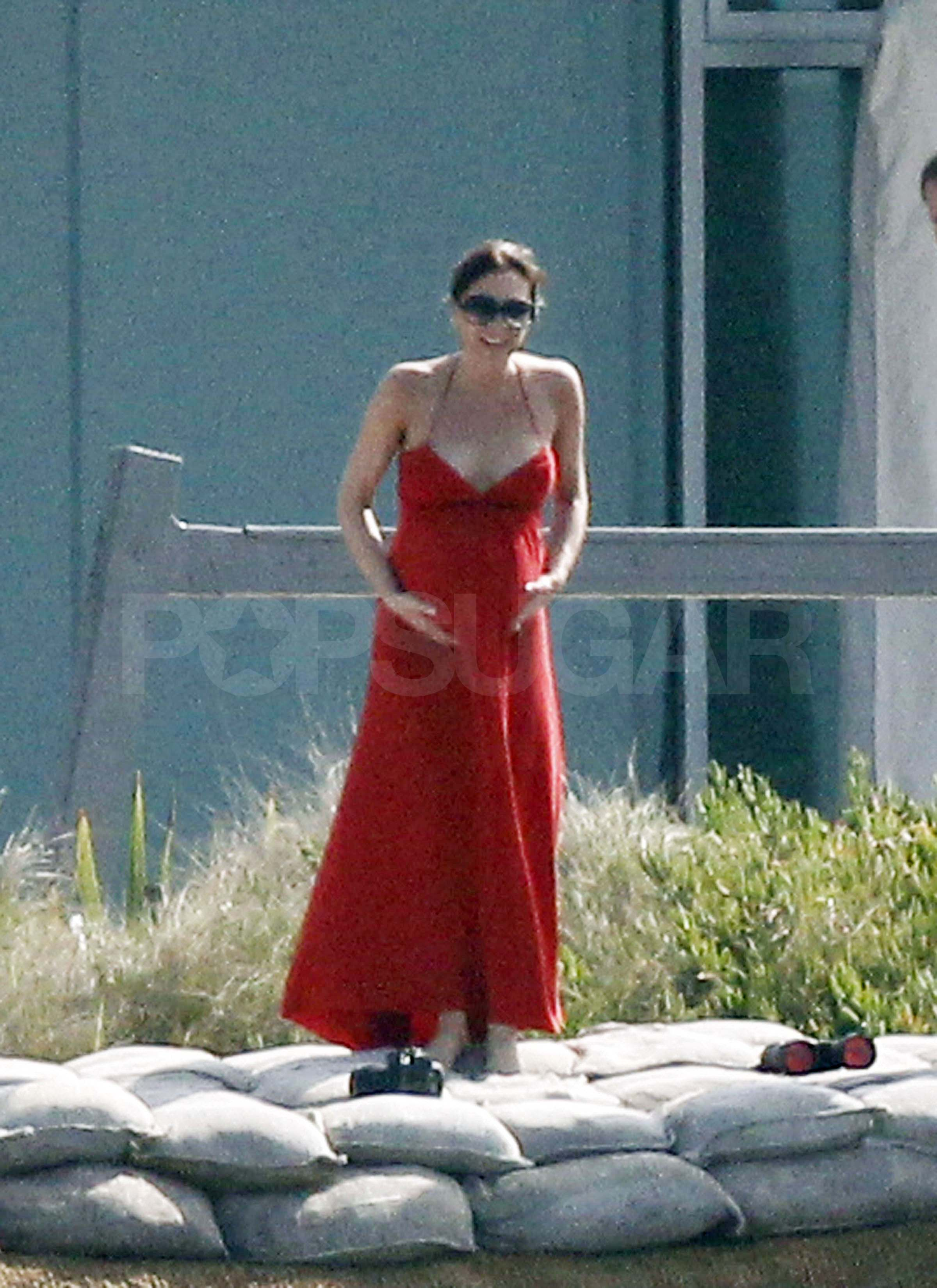 Pregnant victoria beckham in a red dress in malibu victoria beckham