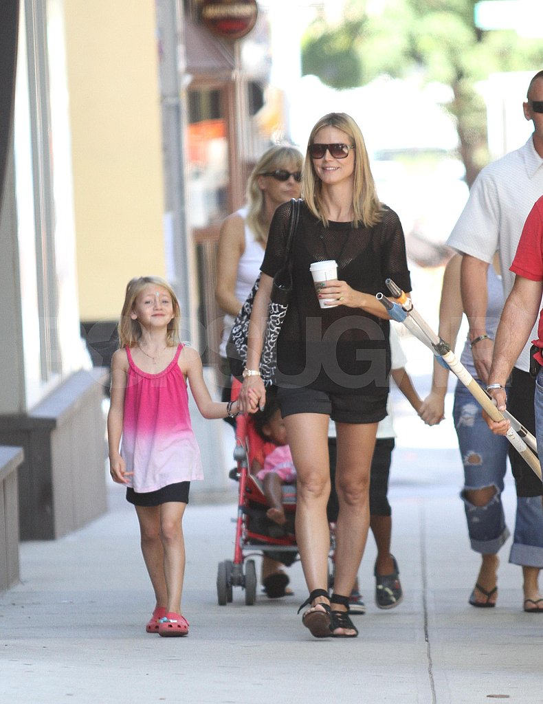 Heidi Klum carried a coffee and was hand in hand with Leni Samuel.