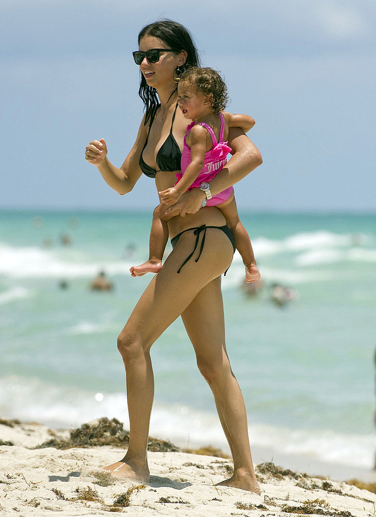 Adriana Lima Dons a Little Black Bikini to Play on the Beach With Baby Valentina!