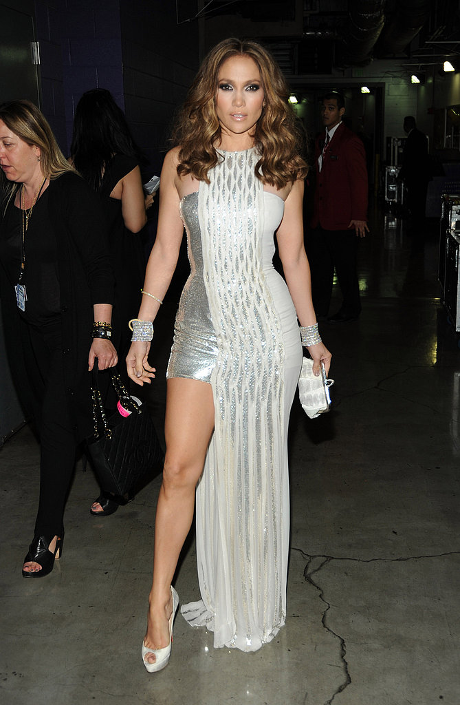 Showing Off Her Toned Gams In A Metallic Versace At The