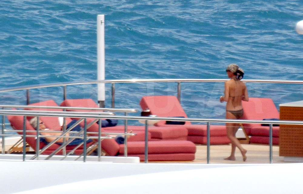 Catherine Zeta-Jones wears a bikini on a yacht in Italy with Michael Douglas.
