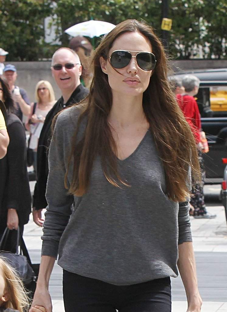 Angelina Jolie in a gray sweater.