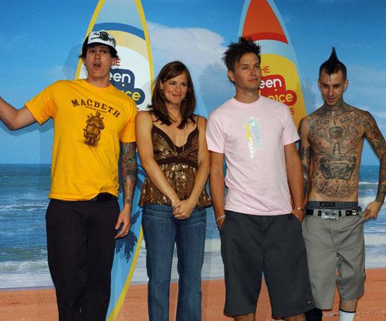 Jennifer Garner was surrounded by the guys of Blink-182, Tom DeLonge, Mark Hoppus and Travis Barker, backstage in 2004.