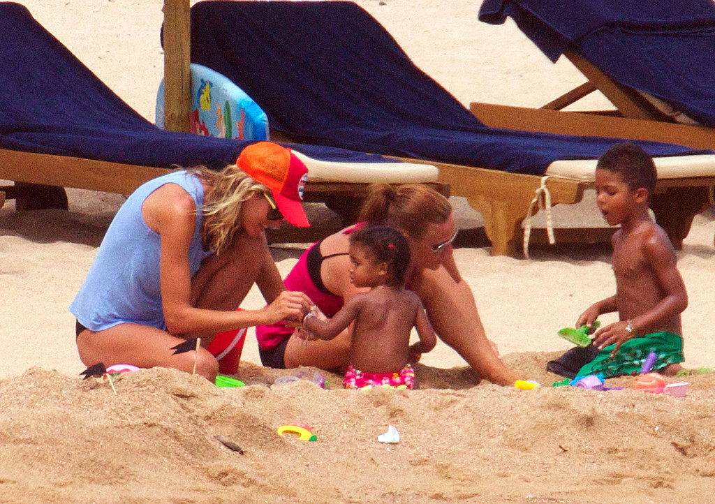 Heidi Klum Rocks Her Little Black Bikini on a PDA-Filled Beach Day With the Whole Family