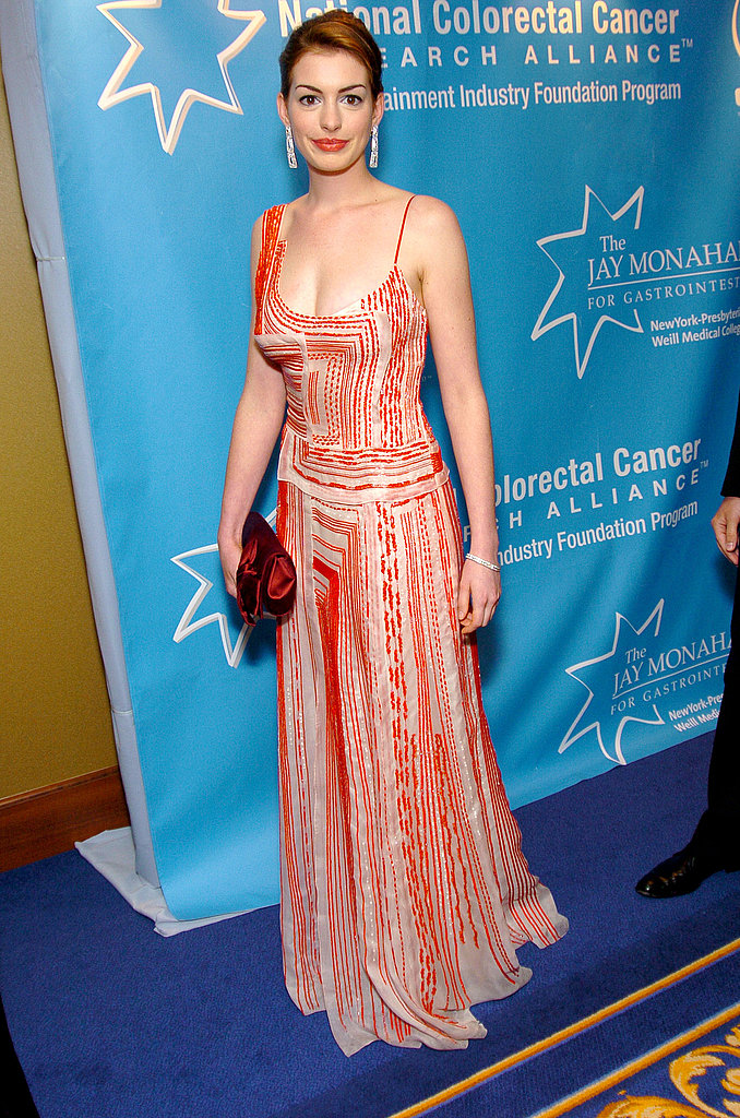 A printed maxi for a benefit in April 2004 hints at coming change in her style.