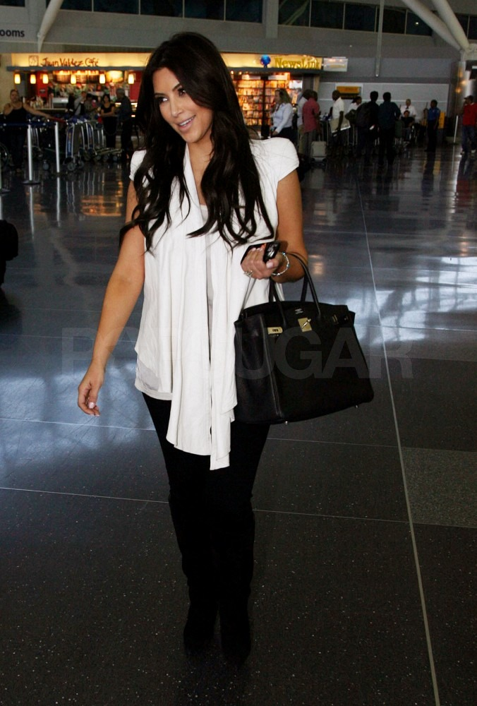 Kim Kardashian smiled to fans at JFK.