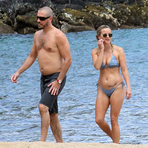 In August 2011, Reese Witherspoon and Jim Toth hit the beach in Hawaii.