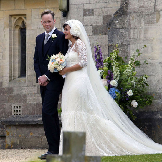 Karl Lagerfeld is responsible for the totally unique lace gown Lily Allen wore while marrying Sam Cooper at James the Great Church in Gloucestershire, England, during a June 2011 ceremony.