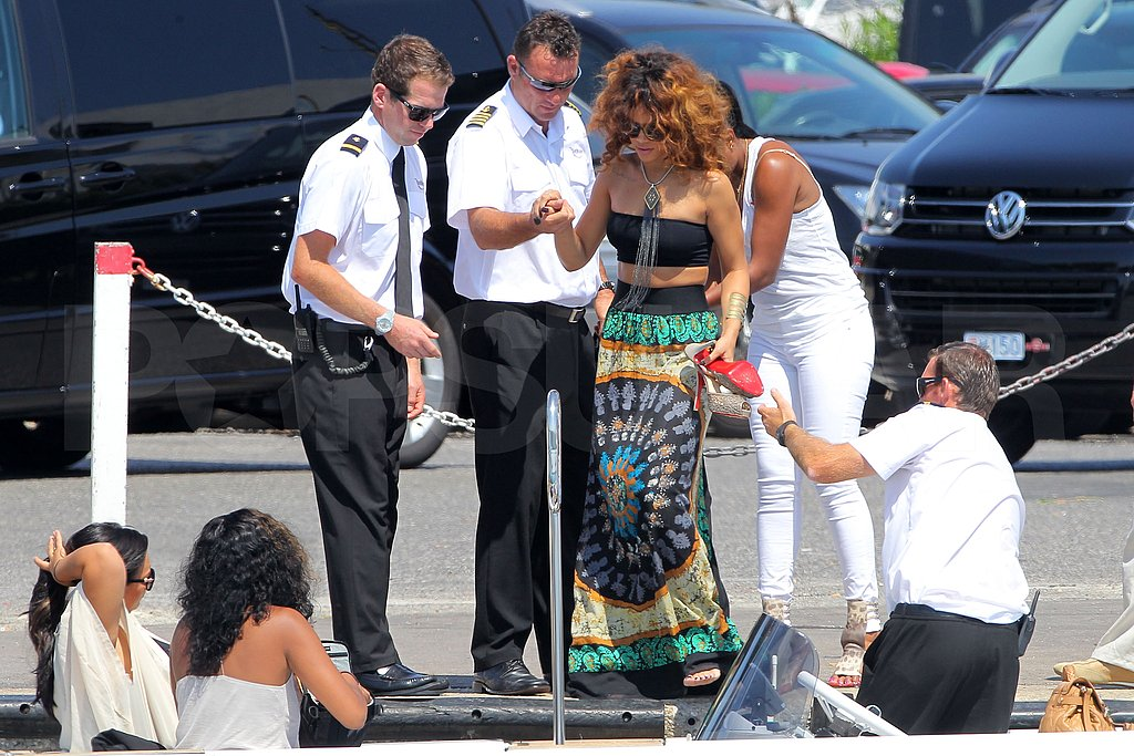 Rihanna got a hand from the boat crew.