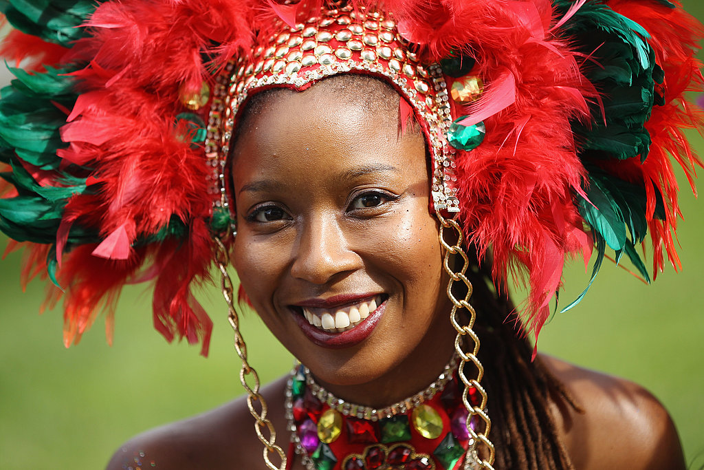 A Woman In The Genesis Mas Band Smiles Ahead Of The
