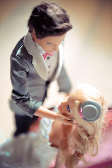 Groom Ken gazes at his bride. Photo by BdG Photography via Rock n Roll Bride