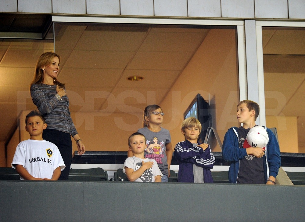 Cruz, Brooklyn, and Romeo Beckham went to their father's soccer game.