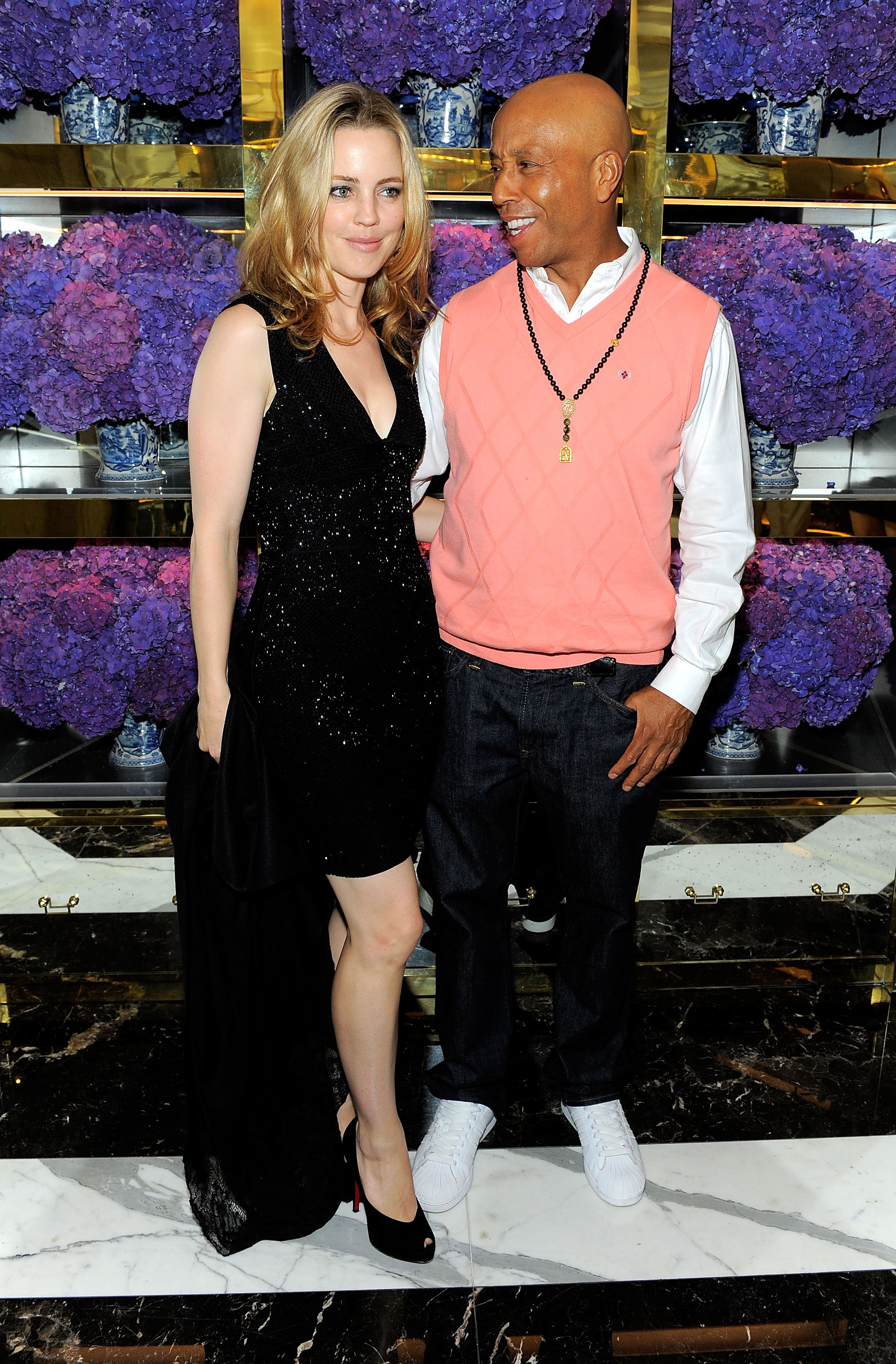 Russell Simmons and Melissa George at Tory Burch store opening in NYC.