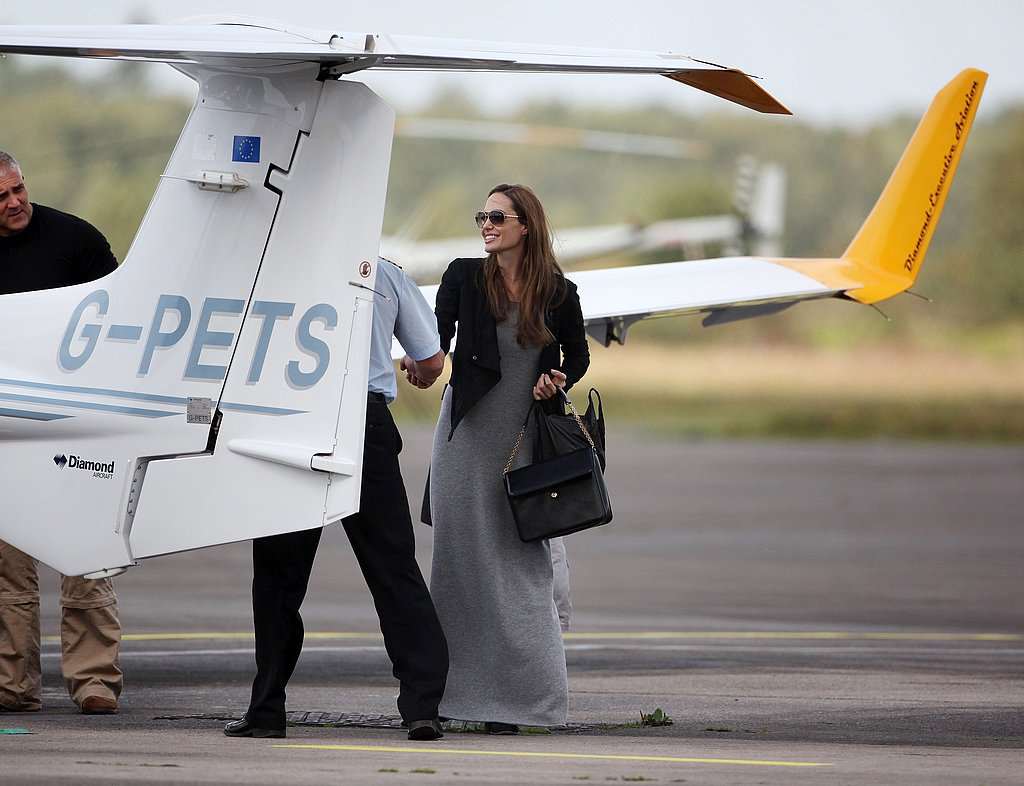 Angelina Jolie by a small private plane.