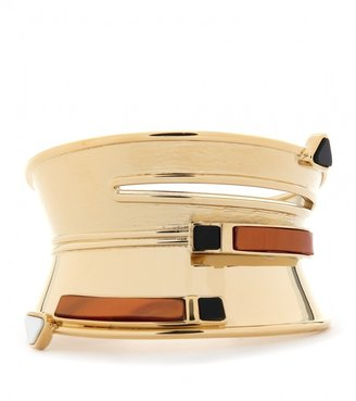 The perfect modern accompaniment to any minimal look.  Vionnet Sculpted Band Cuff ($375)