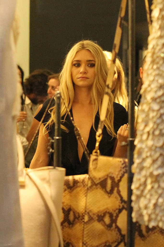 Ashley Olsen checked out her handbag collection in a Paris shop.