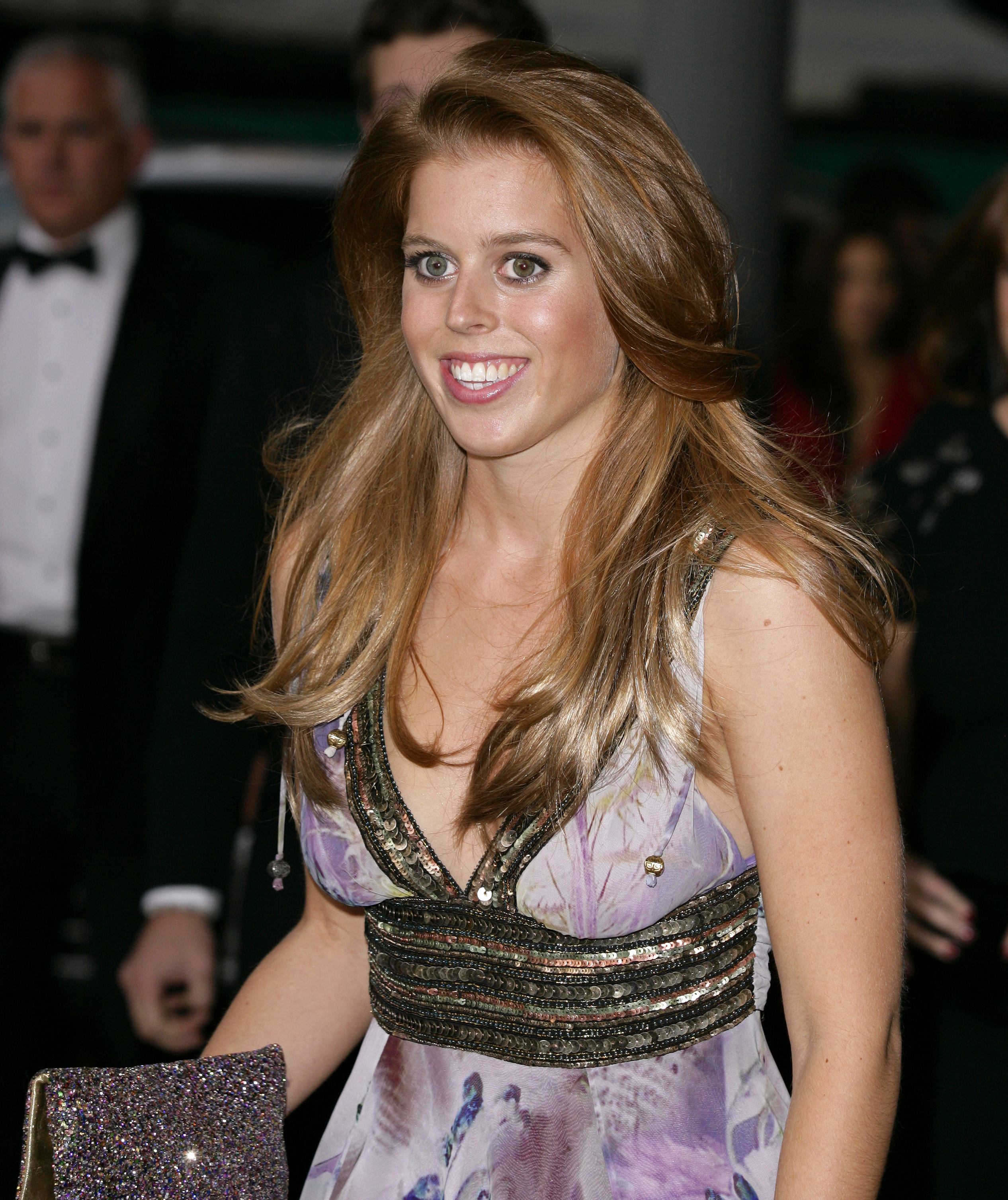 Princess Beatrice smiles in London.