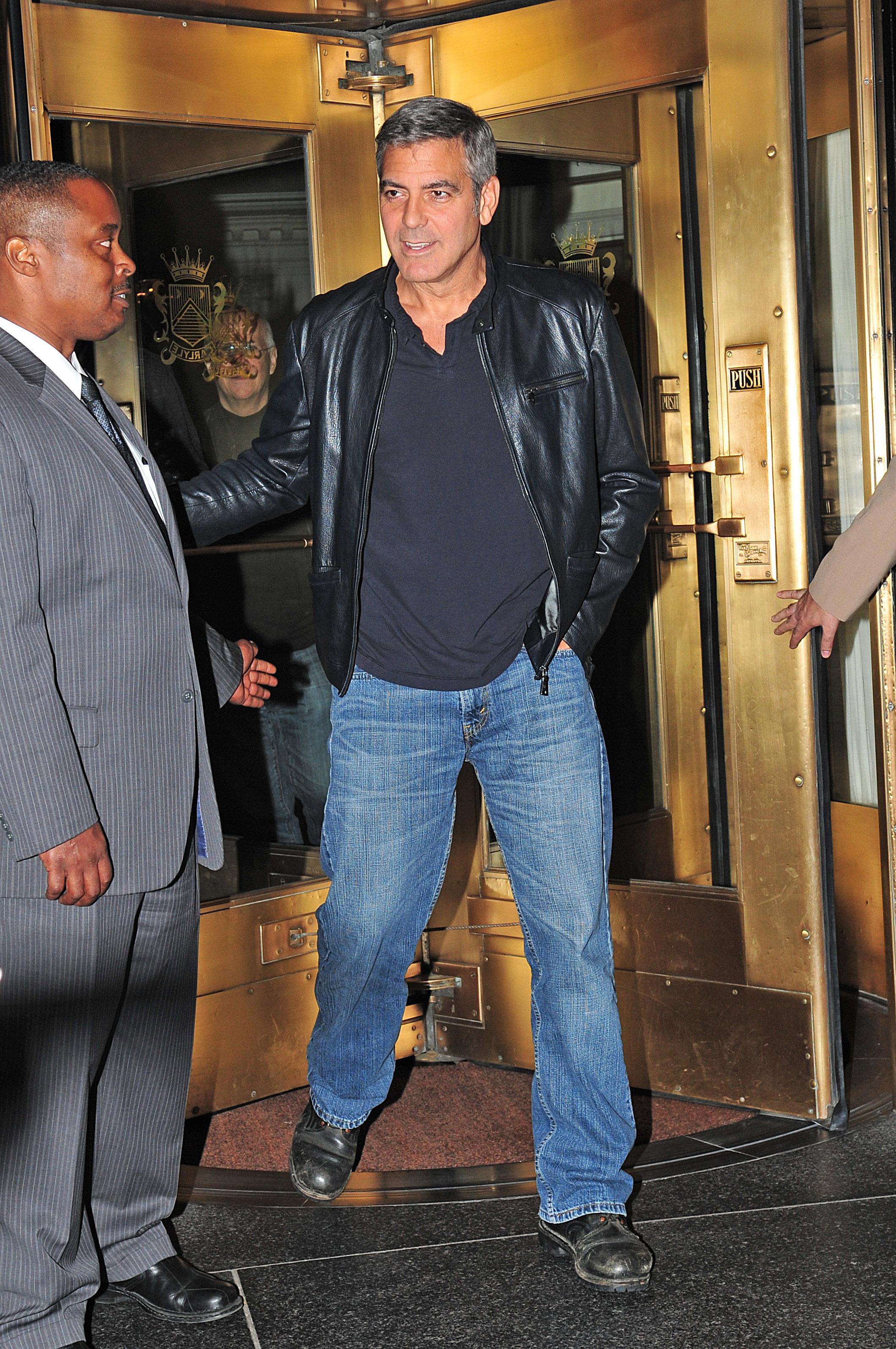 George Clooney stayed warm in a leather jacket in NYC. | George