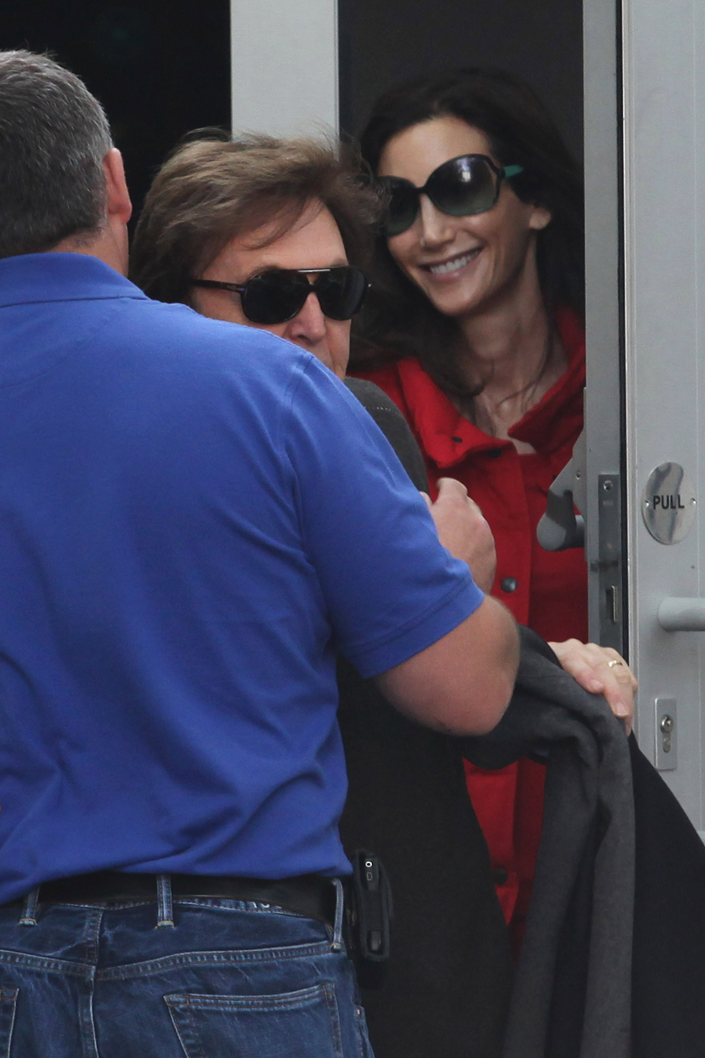 Paul McCartney leads the way out to his car with wife Nancy Shevell.