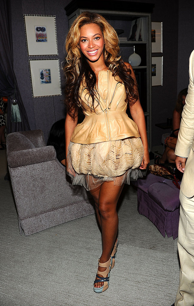 Beyoncé wore a short leather dress during a Fashion Week appearance.