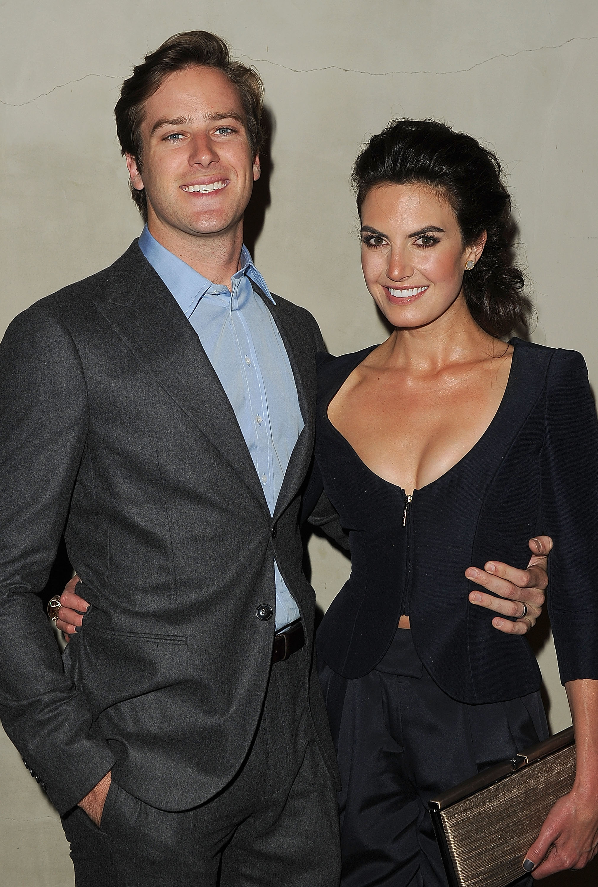Armie Hammer and Elizabeth Chambers wrapped their arms ...