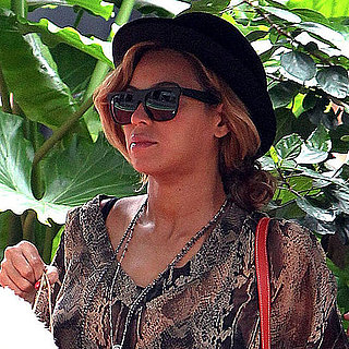 Pregnant Beyonce With an Umbrella-Holding Assistant Pictures