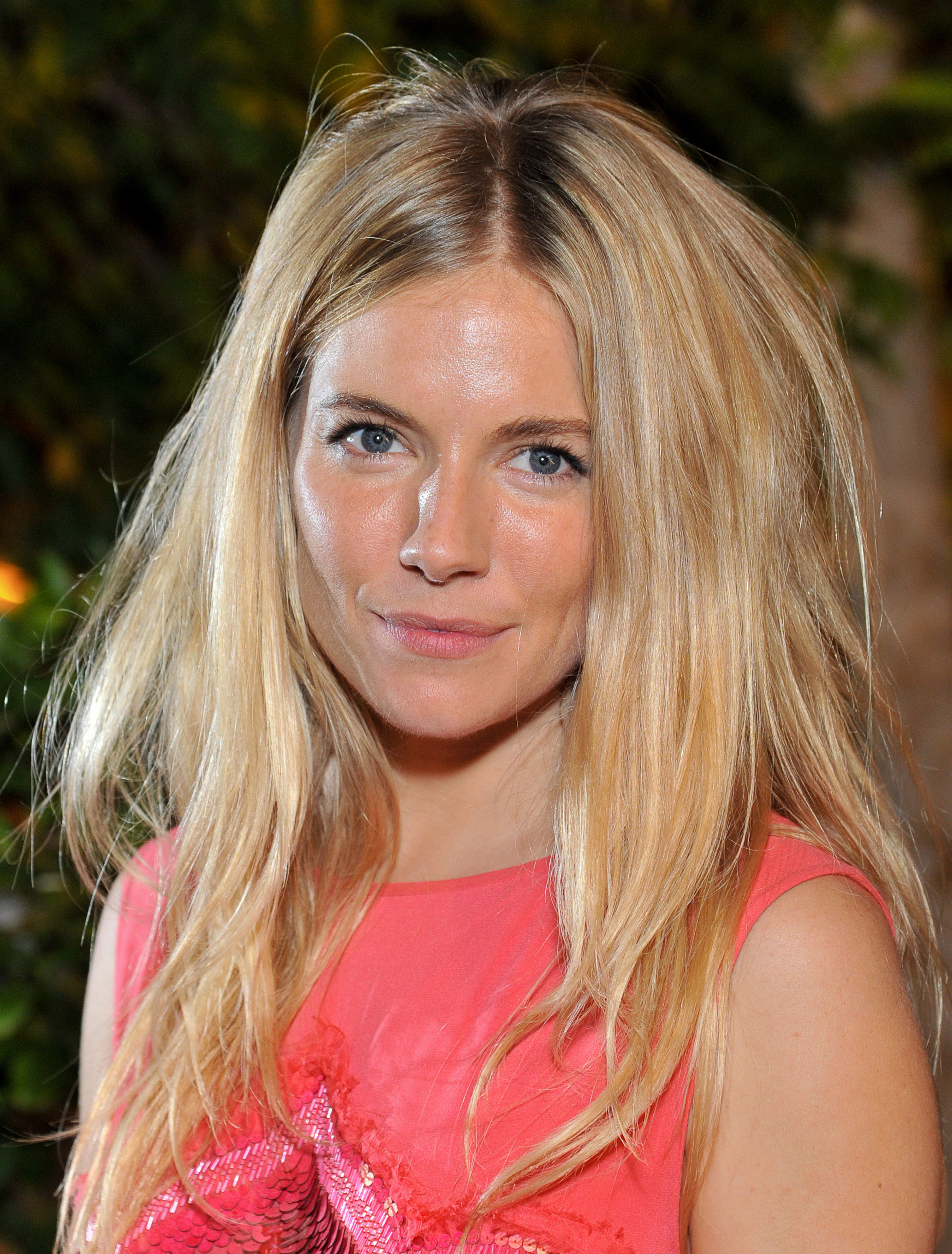 Sienna Miller at a charity event in England.