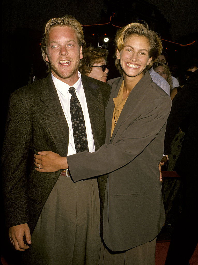 She smiled and snuggled with then-fiancé Kiefer Sutherland at the Young Guns II premiere in 1990.