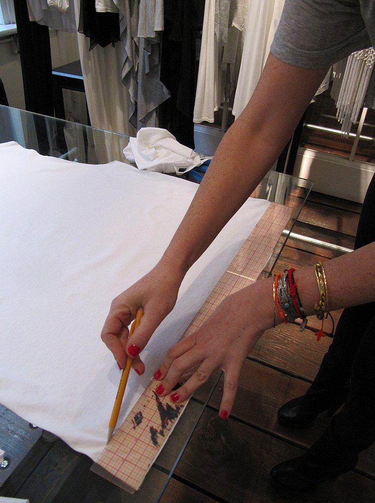 Mark 1.5-inch strips across the t-shirt, using a pencil, going all the way up to the armpit seam.