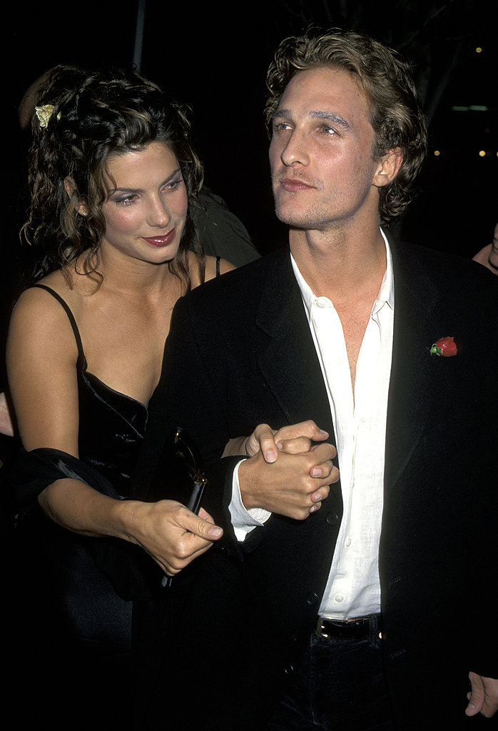 Sandra Bullock and Matthew held hands at the LA In Love and War premiere in January 1997.