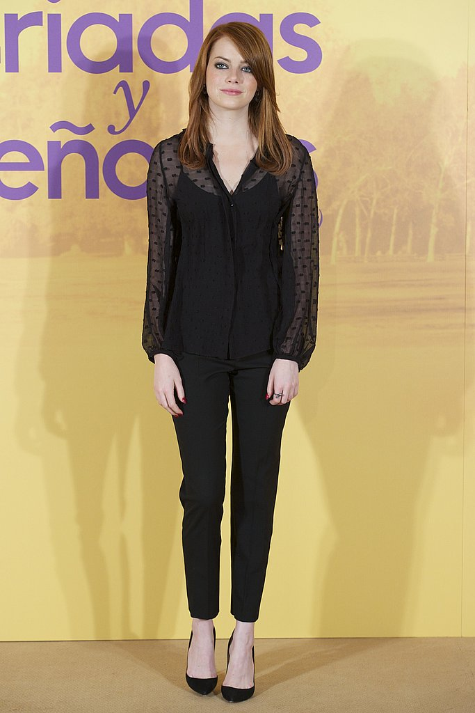 Emma took on Fall's polka-dot trend in a sheer blouse at a photocall in Spain. . .