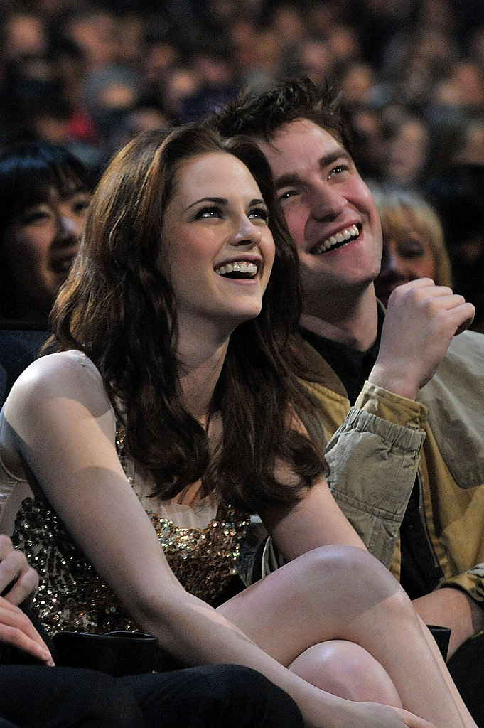 Robert Pattinson and Kristen Stewart sat close and laughed during the 2011 People's Choice Awards in LA in January.