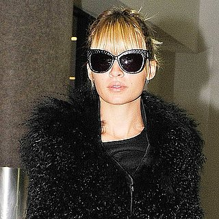 Pictures of Nicole Richie at LAX in Faux Fur Vest and House Of Harlow Accessories